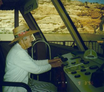 Granny driving a houseboat